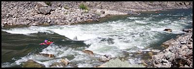 Kayaker entering Cramer Creek Rapid, Main Salmon, ID