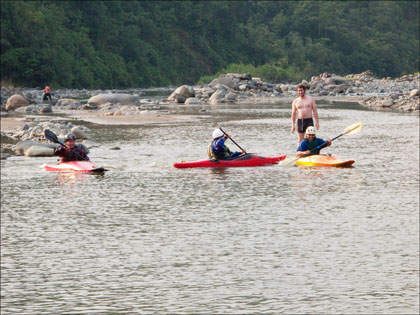 Juan Francisco, Carlos and Santiago all attempt to paddle a straight line under the watchful eye of Kiki.