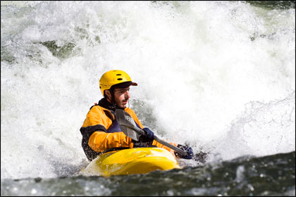 Nick_B._kayaker_surfing_Midel_Fork_Salmon_Idaho