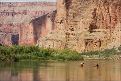 Kayakers take in the sites while floating near Saddle Canyon, Grand Canyon.