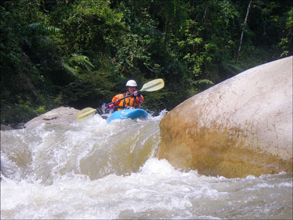 Kayaker boof Rio Jondachi, Ecuador.