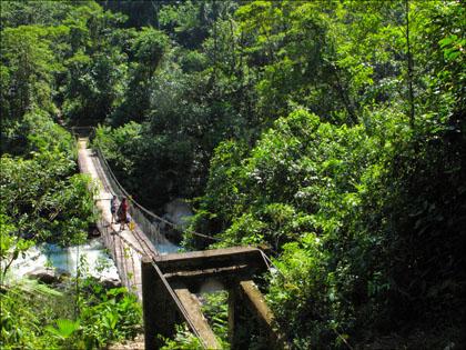 Footbridge on lower Jondachi, Ecuador.