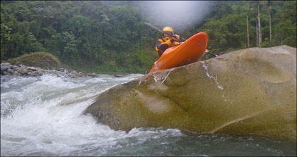 Kayaker boofing rock.