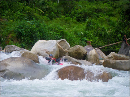 Kayaker on the Upper Misahualli near Archidona, Ecuador