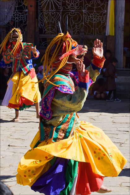 Masked dancer performing during the Jambay Lhakhang Drub festival in Chumkar.