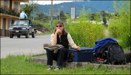 Mary DeRiemer waiting roadside in Quijos valley, Ecuador.