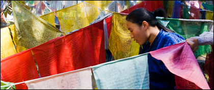 Bhutan_prayer_flags_woman_burning_lake