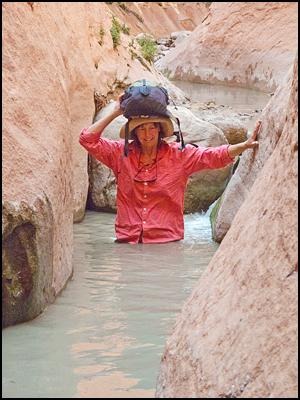 Hiker_Wading_Canyon_Escalante