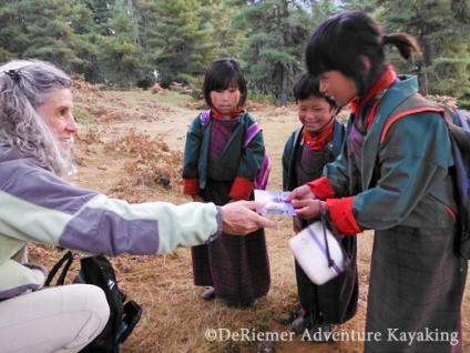 Janet sharing with school girls walking home on the Nature Trail. Phobjika, Valley of the rare Black Necked Crane..