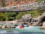 "Leslie passes under the ""Iron Monk"" bridge on the Pa Chu."