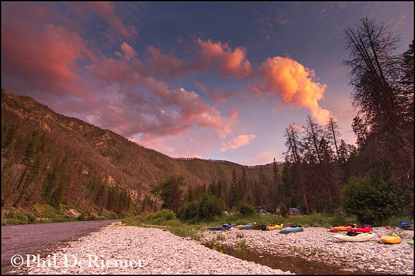 Sunset_clouds_kayaks_camp