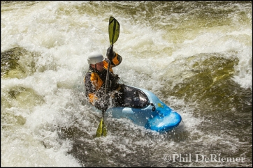 sexagenerian_kayaker_surf