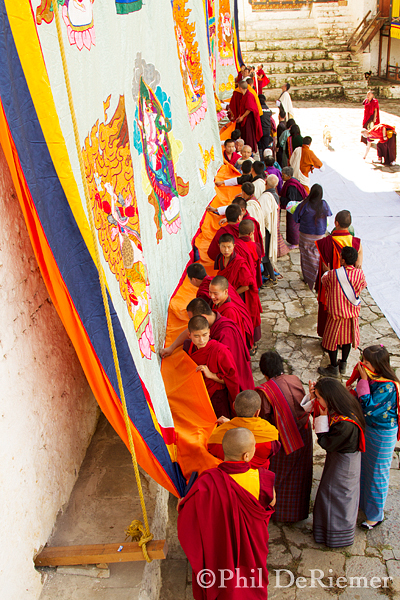 Monks_Rolling_thangka_Bhutan