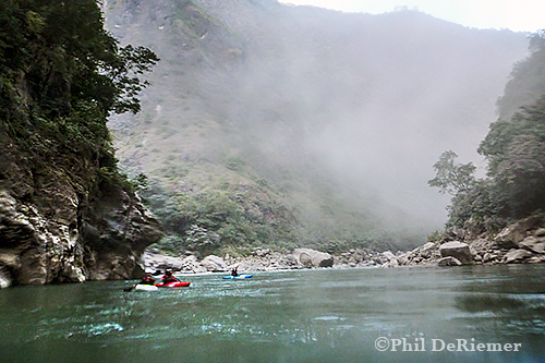 Dust from road construction on the Drangme Chu blows up river at the confluence with the Kuri Chu.